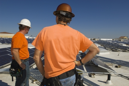 solar power plant: Electrical Engineers Working at Solar Power Plant