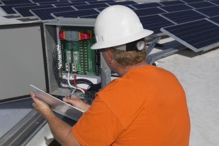 solar power plant: Engineer Working on Electrical Box at Solar Power Plant