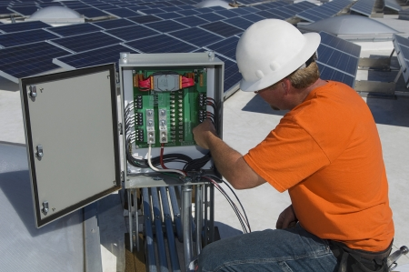 solar power plant: Electrical Engineer Among Solar Panels at Solar Power Plant