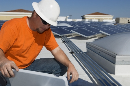 electrical engineer: Electrical Engineer Working at Solar Power Plant