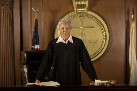court judge: Female judge standing in court portrait LANG_EVOIMAGES