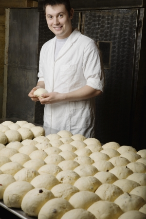 boulangerie: Baker With Balls of Bread Dough Ready to Bake LANG_EVOIMAGES