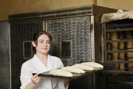 boulangerie: Baker Carrying Loaves of Bread Dough to Bake