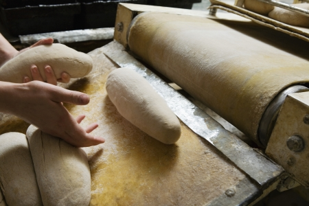 boulangerie: Baker Preparing Bread Dough