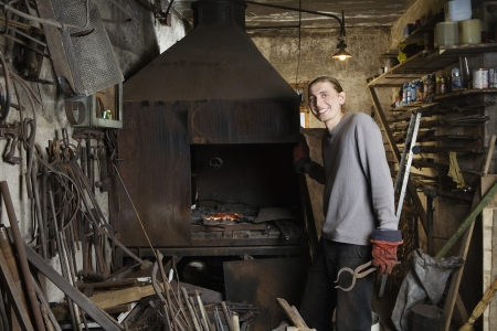 Blacksmith Standing by Forge Stock Photo - 20715806