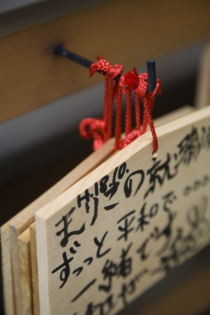 ema: Japan Takayama Small wooden plaques with prayers and wishes (Ema) hanging on hook LANG_EVOIMAGES