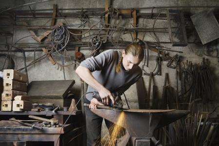 blacksmith shop: Blacksmith Working in Shop