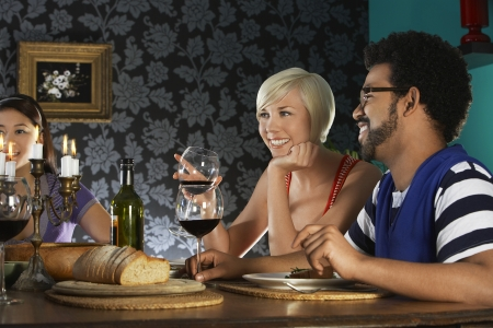 two people with others: people sitting at dining table