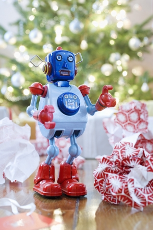 vintage: Toy robot in front of Christmas tree