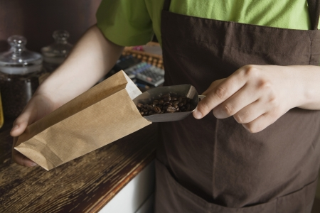 salespeople: Salesperson Scooping Coffee Beans Into Bag