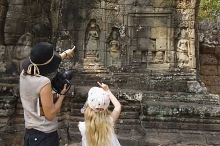 digital camera: Woman and Girl Looking at Ancient Temple