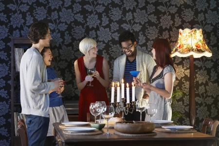 Group of people laughing standing by dining table Stock Photo - 20715978