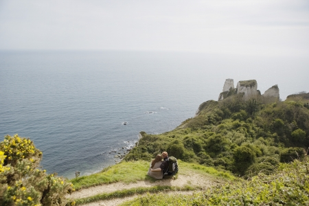 overlook: Couple Sitting on an Outlook Above the Water