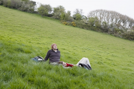 25 to 30 year olds: Young Couple Relaxing in the Grass