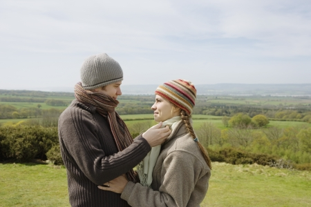 25 to 30 year olds: Young Couple Standing in a Field