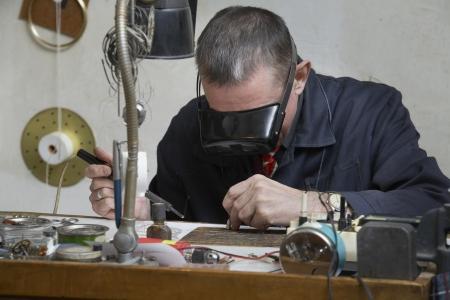late fifties: Clock Repairman at Work LANG_EVOIMAGES