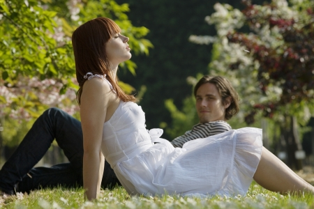 20 25 years old: Young Couple Sitting in the Grass