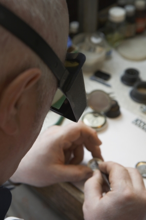 early 60s: Watch Repairman at Work