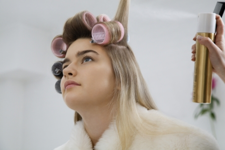 20 to 25 year olds: Model Having Hair Put in Curlers