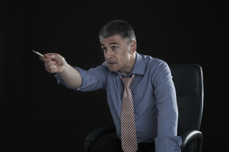 45 to 50 year olds: Angry Businessman Pointing a Pen