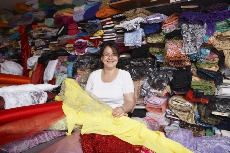 middle easterners: Fabric Store Worker