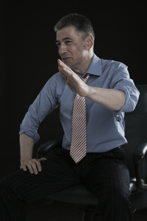 45 years old: Businessman Laughing and Gesturing