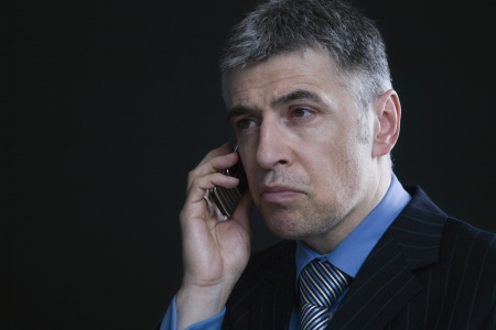 45 50 years: Worried Businessman on the Telephone