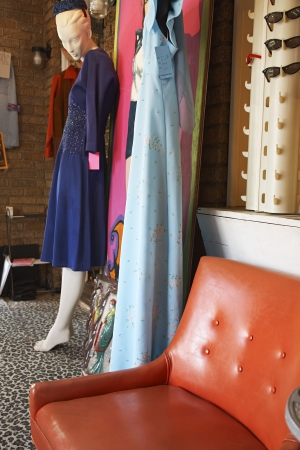 Clothing and Furniture in Crowded Second Hand Store Stock Photo - 20716269