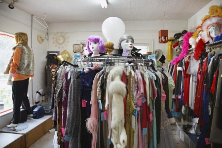 Clothing and Wigs in Crowded Second Hand Store Stock Photo - 20716272