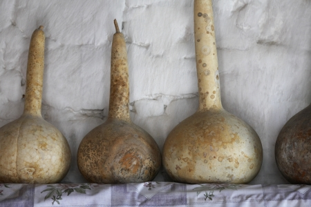 aligning: Old Gourds on a Shelf in Ancient Village House