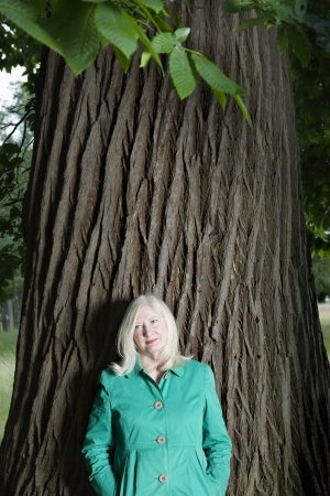 age 50 55 years: Woman Standing Beneath a Tree