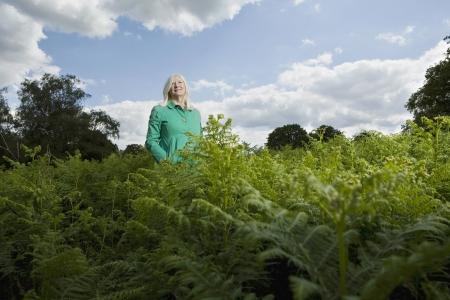 half length posed: Woman Standing Among Ferns