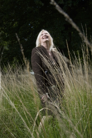 late fifties: Woman Standing in a Meadow