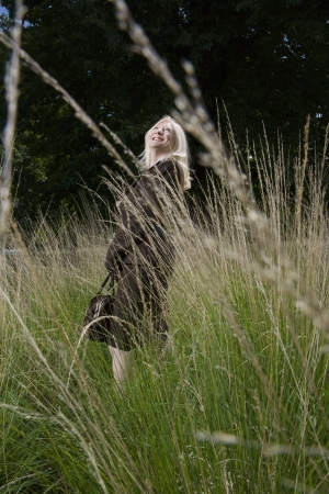Woman Standing in a Meadow