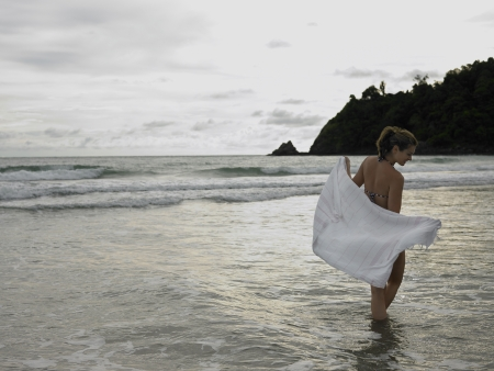 20 25 years old: Young Woman Wading in Ocean