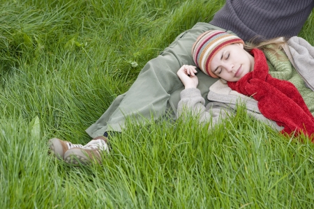 20 to 25 year olds: Young Couple Relaxing in the Grass