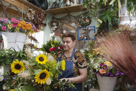 65 70 years: Florist Working in Shop
