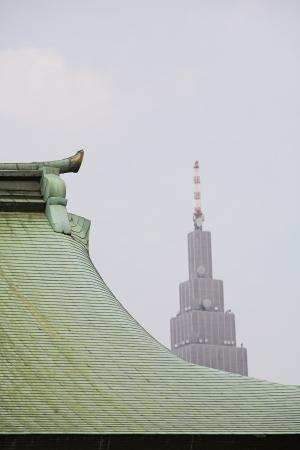 harajuku: Modern Skyscraper Behind Traditional Roof of Meiji Shrine LANG_EVOIMAGES