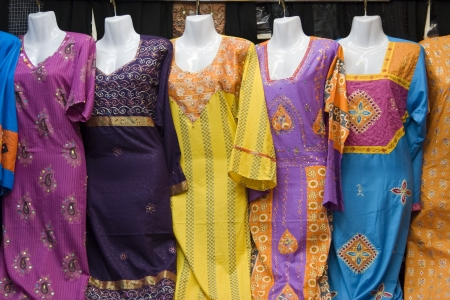 naif: Dubai UAE Colorful womens dresses are displayed for sale at the Al Naif souq in Deira LANG_EVOIMAGES