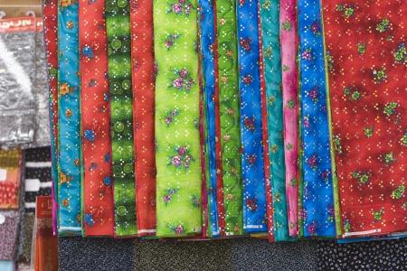 bur dubai: Dubai UAE Bright colored fabrics are for sale in the Bur Dubai souq.