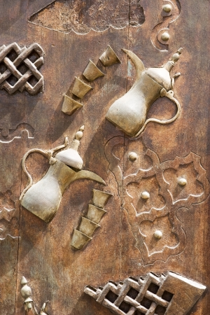 ornately: Dubai UAE Ornately decorated wood doors at Heritage Village in Bur Dubai