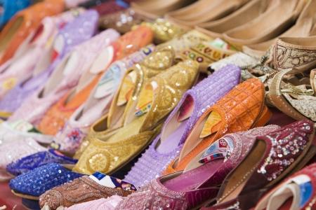souq: Dubai UAE Colorful women?ɬ???�����??��?�?s sandals made of camel skins are for sale in the Bur Dubai souq.