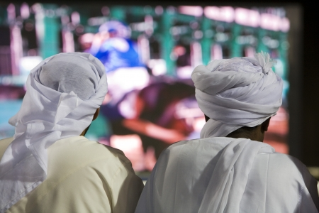 middle easterners: Dubai UAE Two men traditionally dressed in dishdashs and gutras