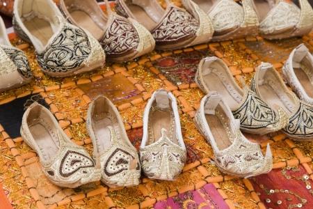 souq: Dubai UAE Genie style sandals are for sale in the Bur Dubai souq in women?ɬ???�����??��?�?s and children?ɬ???�����??��?�?s sizes.