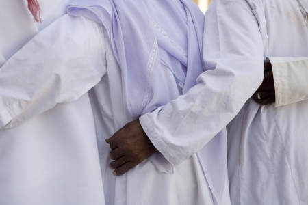 middle easterners: UAE Dubai group of traditionally dressed Muslim men perform a song for visitors to the Bastakia
