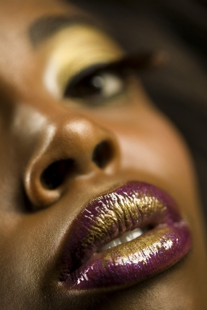 Young Woman with Purple and Gold Lipstick