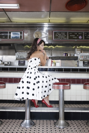 20 25 years old: Young Woman in a Diner