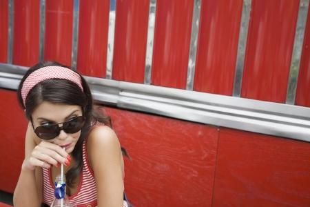 soda pop: Young Woman Drinking a Soda