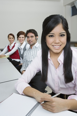 Cheerful Multi Racial Group of Business people Sitting at Desk Stock Photo - 20716698