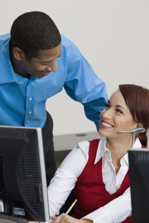 Woman Wearing Headset Chatting with Colleague Stock Photo - 20716699